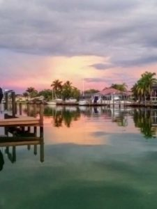 Waterfront Houses along a Cape Coral Canal during sunset
